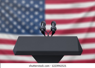 Podium lectern with two microphones and United States flag in baackground