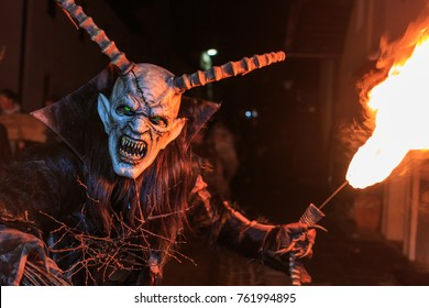 "PODKOREN, SLOVENIJA - NOVEMBER 24th 2017: Unidentified man wears Krampus (devil) mask at traditional procession  ""Parkelj gathering"" in Podkoren, Slovenia"