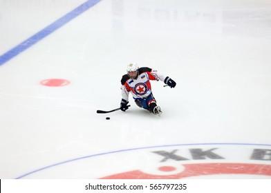 PODOLSK, RUSSIA - JANUARY 14, 2017: Unidentified player of Zvezda (white) team of Sledge hockey during game Vityaz vs AKBars on Russia KHL championship on January 14, 2017