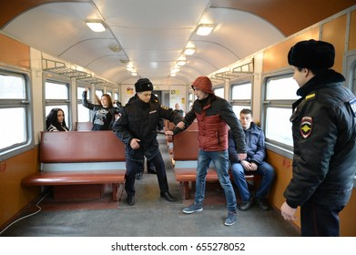PODOLSK, RUSSIA - MARCH 26, 2015:The work of the police detention of violators of public order on the train.