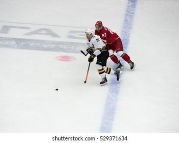 PODOLSK, RUSSIA - NOVEMBER 13, 2016: M. Trunyov (81) and A. Dostoinov (62) in action on hockey game Vityaz vs Severstal on Russia KHL championship, 2016, in Podolsk, Russia. Vityaz won 4:0