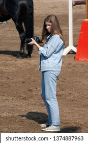 PODOLSK, RUSSIA - SEPTEMBER 1, 2018: Unidentified reporter with photocamera during The Dressage and jumping cup of A.V. Nikulin memory