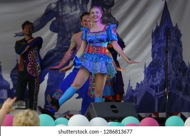 PODOLSK, RUSSIA - SEPTEMBER 9, 2018: Unidentified dancer of Yarmarka band dancing on Day of the Moscow city event. Event in Znamya Oktyabrya district on September 9, 2018