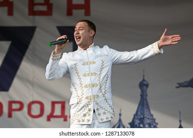 PODOLSK, RUSSIA - SEPTEMBER 9, 2018: Dmitry Artyomenko sing a song on Day of the Moscow city event. Event in Znamya Oktyabrya district on September 9, 2018