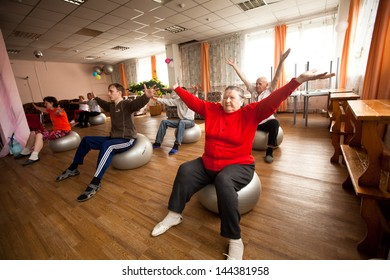 PODPOROZHYE, RUSSIA - OCT 11: Fitness training for elderly and disabled in program Day of Health in Center of social services for pensioners and disabled Otrada, Oct 11, 2012 in Podporozhye, Russia.