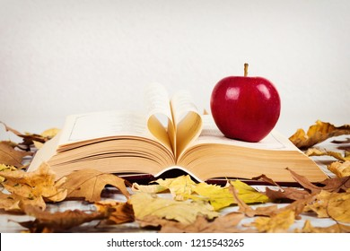 Poetry book with apple and leaves