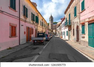 POGGIO, ELBA ISLAND, ITALY - SEPTEMBER 16, 2018: Small street with colorful houses in a town Poggio on Elba island.