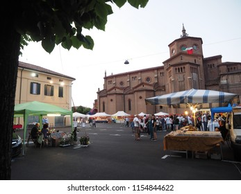 Poggio Renatico, Italy - June 1, 2018. Poggio Street Festival, country fair. The square with the church and the stalls.