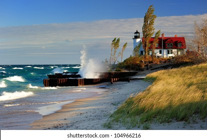 Point Betsie Lighthouse Frankfort, Michigan USA Gale force wind and waves crashing . Sunrise