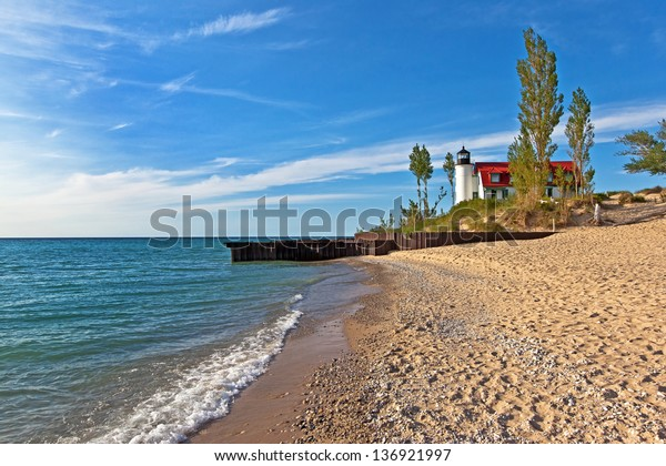 Point Betsie Lighthouse on the shores of Lake Michigan on a summer day