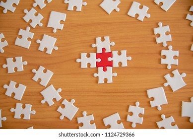 point holding connecting red and White ,Business connection,Success and strategy concept one finger , point pieces of jigsaw puzzle,Teamwork concept