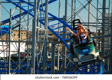 Point Pleasant, NJ, USA July 25 A young boy and girl enjoy a downhill run on a roller coaster in Point Pleasant, New Jersey