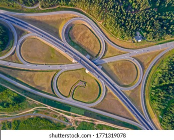 The point road junction, which go in different directions with different speeds of cars and trucks. Live along the main highway. top view from a height at an angle of 90 degrees. Wallpaper, textures