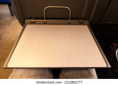 point of view of an empty seat tray in the train. waiting for food, drinks, and snacks.