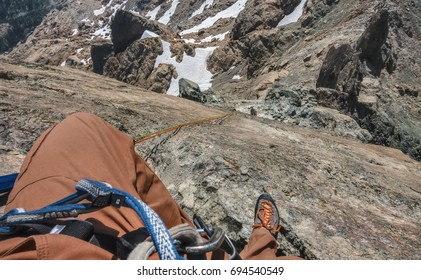 Point of View Image of Two Rock Climbers Rappelling into the Rocks and Snow of the Cascade Mountain Range