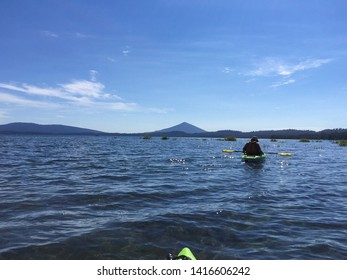 Point of view landscape of a man in a kayak on Waldo Lake in Oregon