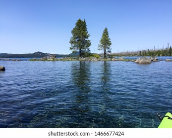 Point of view landscape of rocks and trees at Waldo Lake in Oregon