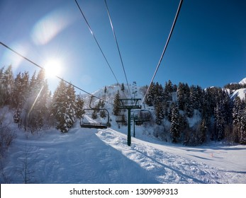 Point of view from a ski lift at Sundance Ski Resort on a beautiful sunny winter day in Utah.