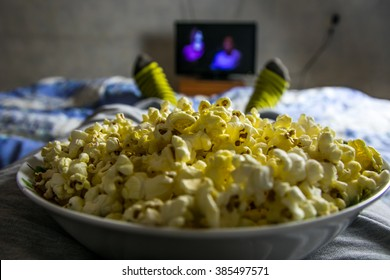 Point of view TV watching. Man watch movie with popcorn.