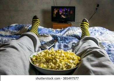 Point of view TV watching. Man watch movie with popcorn