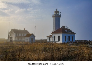 Point Wilson Lighthouse with sun glow