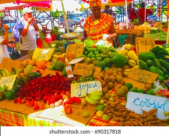 Point-a-Pitre, Guadeloupe - February 09, 2013: woman sells fresh fruit at the outdoor market in Guadeloupe.