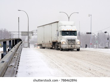 POINTE CLAIRE, QUEBEC/CANADA - DECEMBER 9, 2008  - Semi trailer truck attempts to navigate icy St. John's overpass during severe winter storm