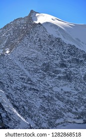 Pointe de Mourti with tracks in the ice, in the Val d'Anniviers in the Southern Swiss Alps above Grimentz