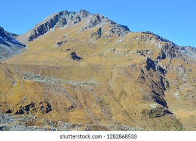 The Pointe du Bandon with patches of snow in the Val d'Anniviers in the Southern Swiss Alps