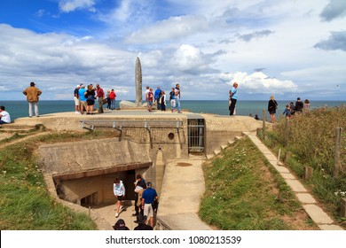 Pointe du Hoc, France - August 2, 2014: Tourists visit the WW2 Ranger Monument at Pointe du Hoc near Omaha beach, Normandy, France, on August 2, 2014