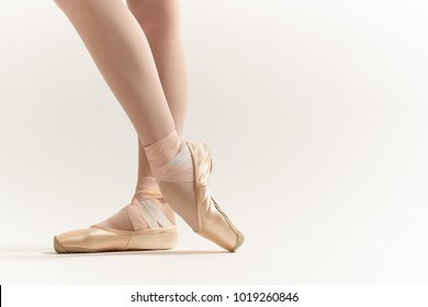 pointe shoes on a light background