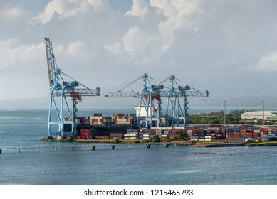 Pointe-a-Pitre, Guadeloupe - December 20, 2016: Cranes in the port and ship loading in the port of Pointe-a-Pitre, Guadeloupe, an overseas region of France located in the Lesser Antilles, Caribbean.