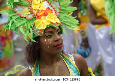Pointe-a-Pitre, Guadeloupe, February 11, 2018: Portrait of a beatiful black girl in fancy dress participating at carnival parade in Guadeloupe, Caribbean