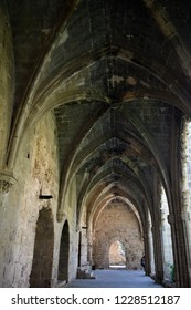Тhe pointed arch, the flamboyant Gothic style, stone ornaments.The interior is Gothic. Gothic Abbey. Medieval Abbey. Bellapais Abbey. Cyprus