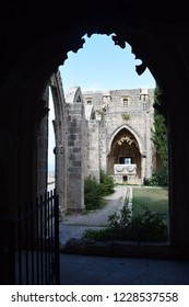 The pointed arch, the flamboyant Gothic style, stone ornaments.The interior is Gothic. Gothic Abbey. Medieval Abbey. Bellapais Abbey. Cyprus