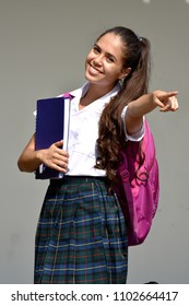Pointing Colombian Girl Student Wearing School Uniform
