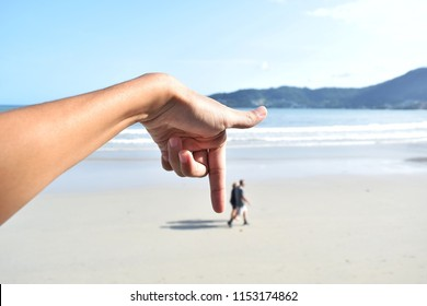 Pointing fingers to stop. The background is beautiful sea.