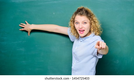 pointing on you. knowledge day. empty blackboard information. university or college life. woman teacher at school lesson. back to school. woman likes studying. student at blackboard. copy space.