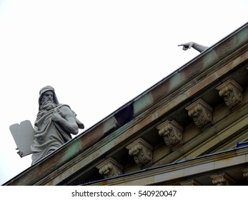 Pointing statue on church