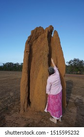 Pointing to the top of the huge anthill to what resembles a human face, far North Queensland.