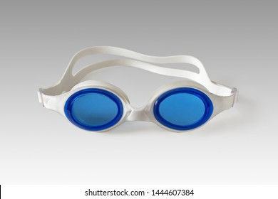 Points for sport swimming with the blue glasses of white rubber on the surface of the light table