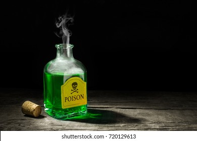 The poison is a green liquid in a glass vial. A deadly potion with a skull and bones on the label. Copy space for text. 3D rendering