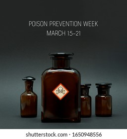 Poison Prevention Week. Brown bottle with warning pictogram stock images. Vial with poison on a dark background stock images. Poison Prevention Week Poster, March 15-21