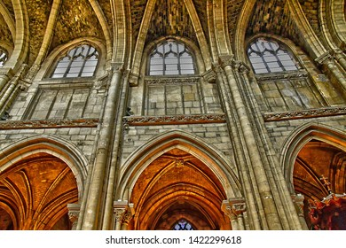 Poissy; France - april 11 2019 : the picturesque collegiate church in spring