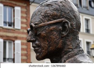 Poissy; France - april 7 2019 : Le Corbusier bronze statue in the city centre