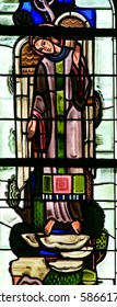 Poissy, France - august 6 2016 : stained glass window of the historical collegiate church where the king Saint Louis was baptised