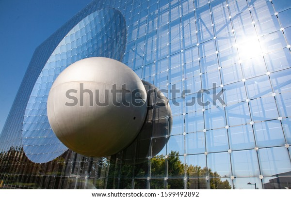 Poitiers, France - September 21 2010 : Glass building in Futuroscope, a French amusement park that lets you experience sounds, images, and sensations