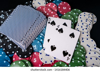 pokdeng or poker witht Chips and card for casino or pile of gambling tokens. Volumetric heap of money or cash for games like poker, blackjack, roulette. Betting club and gamble.