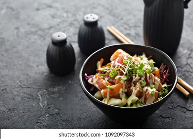 Poke bowl with salmon and vegetables, green onions and microgreens