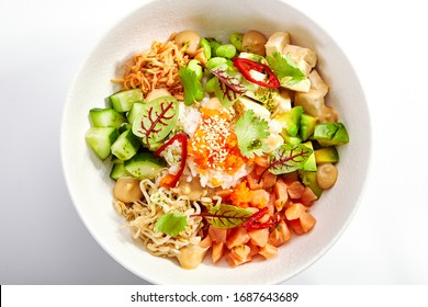 Poke with salmon, cut avocado and tofu side view. Traditional hawaiian dish served with cheese. Delicious salad with rice, edamame and soybean. Native cuisine, exotic food composition